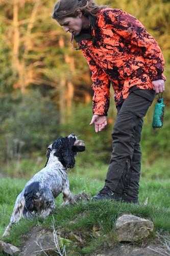 Hannah Spearman APGI taking a retrieve from one of her dogs